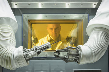 Operator using glove box at MRF