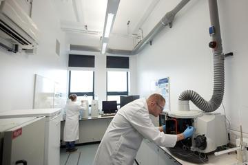Scientists in analytical radiochemistry laboratory